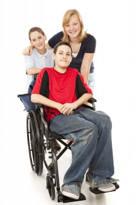 boy in wheelchair with his family
