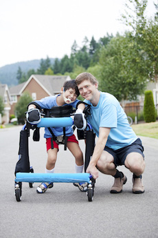 disabled child outdoors using walker